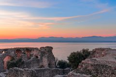 Free Beautiful Multicolor Sunset On Lake Garda. View From The Scenic Ruins Of Grottoes Of Catullus, Roman Villa In Sirmione City, Italy Royalty Free Stock Images - 136204799