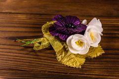 Beautiful multicolored brooch on a wooden table. Beautiful multicolored brooch on rustic wooden table Royalty Free Stock Photography
