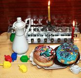 Beautiful multicolored Hanukkah donuts. Pastry decoration on donuts. Chanukia, Sevivon, Dreidl. Beautiful multicolored Hanukkah donuts. Pastry decoration on royalty free stock images