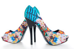 Beautiful multicolored stiletto shoes on white Royalty Free Stock Photos