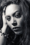 Beautiful multiracial girl in tears. Beautiful broken hearted multiracial girl in black and white royalty free stock images