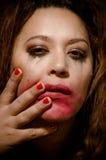 Beautiful multiracial girl in tears. Beautiful broken hearted multiracial girl in tears and messed makeup stock photo