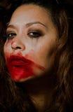 Beautiful multiracial girl in tears. Beautiful broken hearted multiracial girl in tears and messed makeup royalty free stock photo