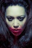 Beautiful multiracial girl in tears. Beautiful broken hearted multiracial girl in tears and messed makeup royalty free stock image