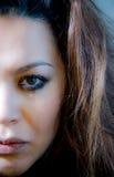 Beautiful multiracial girl in tears. Beautiful broken hearted multiracial girl in tears and messed makeup stock image