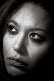 Beautiful multiracial girl in tears. Beautiful broken hearted multiracial girl in tears and messed makeup in black and white stock photos