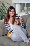 Beautiful multiracial woman sitting on couch mug Royalty Free Stock Photography