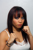 Beautiful Multuracial Girl with Fists Raised Stock Photo