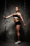 Beautiful muscular bodybuilder woman Stock Photos