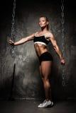 Beautiful muscular bodybuilder woman Stock Photos