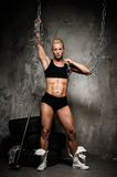 Beautiful muscular bodybuilder woman Stock Images