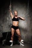 Beautiful muscular bodybuilder woman Stock Images