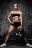Beautiful muscular bodybuilder woman Royalty Free Stock Images