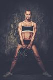 Beautiful muscular bodybuilder woman Royalty Free Stock Photography