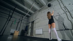 Beautiful muscular fit girl with cross fit ball, mini shorts stock video