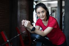Beautiful muscular fit woman exercising building muscles and fit Royalty Free Stock Photo
