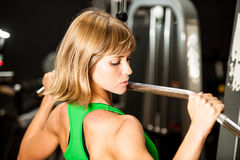 Beautiful muscular fit woman exercising building muscles in fitn Stock Images