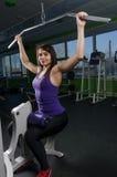 Beautiful muscular fit woman exercising Stock Photo