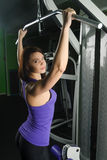 Beautiful muscular fit woman exercising Royalty Free Stock Photos