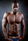 Beautiful and muscular man in dark background. Stock Photos