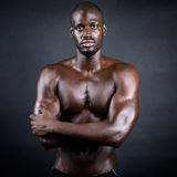 Beautiful and muscular man in dark background. Royalty Free Stock Photography