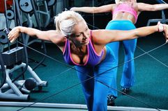 Beautiful muscular woman exercise in a gym Royalty Free Stock Photo