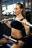 Beautiful muscular woman exercising building muscles Royalty Free Stock Image