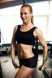 Beautiful muscular woman exercising building muscles Stock Image