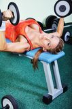 Beautiful muscular woman exercising in gym Stock Photos