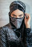 Beautiful Muslim Arabic girl with paranja, only eyes. Portrait of beautiful Muslim Arabic girl with paranja, only eyes Royalty Free Stock Photography