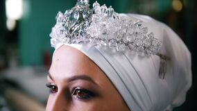 Beautiful muslim bride wearing a turban with the tiara. Close up stock video