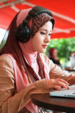 Beautiful Muslim Girl. Using Laptop Royalty Free Stock Photography