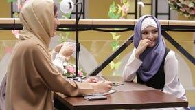 Beautiful Muslim Girl In Cafe stock video footage