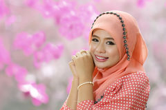 Beautiful muslim girl pink hijab wearing fashion. In the nature Stock Photography