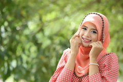 Beautiful muslim girl pink hijab wearing fashion Royalty Free Stock Photography