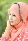 Beautiful muslim girl pink hijab wearing fashion. In the nature Royalty Free Stock Images
