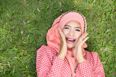 Beautiful muslim girl pink hijab wearing fashion. In the nature Royalty Free Stock Photo