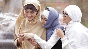 Beautiful Muslim Girl Using Smartphone and Laughing.  stock video