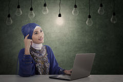 Beautiful muslim has idea under light bulbs Royalty Free Stock Photos