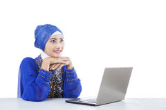 Beautiful muslim looking at laptop - isolated Stock Photo