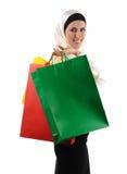 Beautiful Muslim  modern woman. Beautiful Muslim traditional but modern woman holding shopping bags Stock Photo