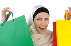 Beautiful Muslim  modern woman. Beautiful Muslim traditional but modern woman holding shopping bags Royalty Free Stock Image