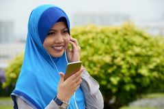 Beautiful Muslim with smartphone stock photos