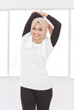 Beautiful muslim sporty woman doing hand stretching Stock Images