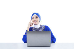 Beautiful muslim thinking with laptop - isolated Stock Photography
