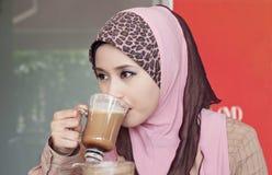 Beautiful muslim woman and coffee. Beautiful muslim woman drink coffee at cafe Royalty Free Stock Photography