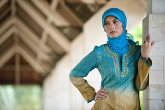 Beautiful muslim woman in front of mosque. Photo of beautiful muslim girl in a mosque Stock Photography