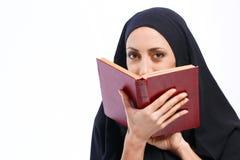 Beautiful Muslim woman holding a book Stock Image