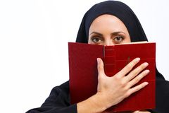 Beautiful Muslim woman holding a book Stock Images