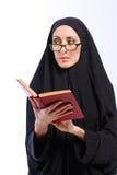 Beautiful Muslim woman holding a book Royalty Free Stock Image